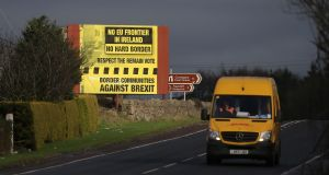 A delivery van passes a Brexit billboard in Jonesborough, Co Armagh, on the Northern side of the Border. Photograph: Niall Carson/PA Wire