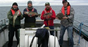 Happy German anglers on Killala Bay
