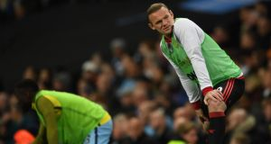 Wayne Rooney of Manchester United warms up during the Premier League match against Manchester City. Photo: Laurence Griffiths/Getty Images