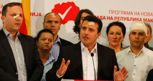 Macedonia's Social Democrats leader Zoran Zaev (centre) and members of his party at a news conference in Skopje on Friday, a day after they were attacked in parliament by right-wing protesters. Photograph: Ognen Teofilovski/Reuters