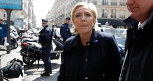 "French presidential candidate Marine Le Pen temporarily resigned as leader of the Front National saying she wanted to be ""above partisan considerations"". Photograph: Charles Platiau/Reuters"