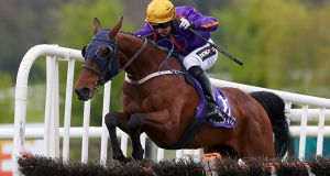 Wicklow Brave ridden by Jockey Patrick Mullins clears the fence on his way to winning the Betdaq Punchestown Champion Hurdle during day four of the Punchestown Festival. Photo: Brian Lawless/PA Wire