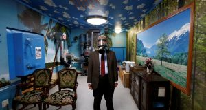 MASKED MAN: Seiichiro Nishimoto, chief executive of Shelter Company, at a model room for the company's nuclear shelters in the basement of his house in Osaka, Japan. Photograph: Reuters