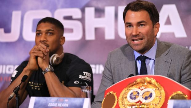 Promoter Eddie Hearn with Joshua during the pre-fight press conference. Photo: Richard Heathcote/Getty Images