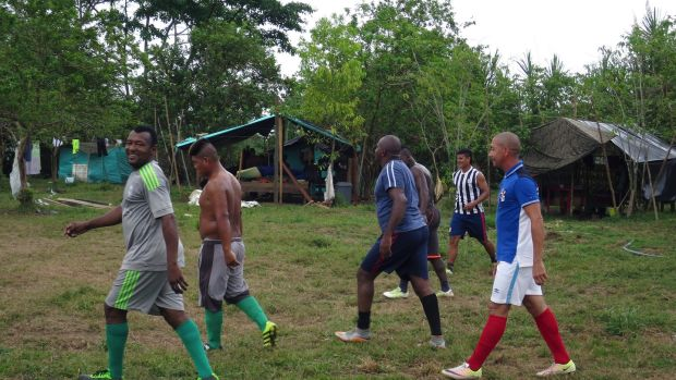Farc guerrillas from the insurgent group's 57th Front playing football at the demobilisation camp in Chocó, Colombia, on March 3rd, 2017. Photograph: Julieta Aponte