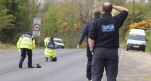 Gardaí at the scene of a fatal crash in Redcastle, Co Donegal in which two young men died. Photograph: North West Newspix