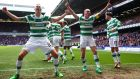 Mikael Lustig and Scott Brown celebrate at Ibrox Stadium. Photograph: Michael Steele/Getty Images