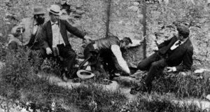 A group of men watch as one of their number goes to kiss the Blarney Stone at Blarney Castle, circa 1880. Photograph: Hulton Archive/Getty Images