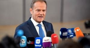 European Council president Donald Tusk speaks with the media as he arrives for an EU summit at the Europa building in Brussels on Saturday. Photograph: AP