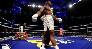 Anthony Joshua reacts after knocking down Wladimir Klitschko during the IBF, WBA and IBO Heavyweight World Title bout at Wembley Stadium in London. Photograph: Richard Heathcote/Getty Images