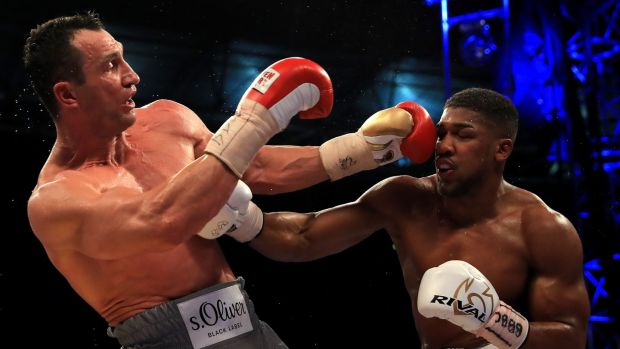 Wladimir Klitschko and Anthony Joshua in action during the IBF, WBA and IBO Heavyweight World Title bout at Wembley Stadium in London. Photograph: Richard Heathcote/Getty Images