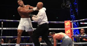 Referee David Fields steps in to stop the fight as Anthony Joshua beats  Wladimir Klitschko to win the the IBF, WBA and IBO Heavyweight World Title bout at Wembley Stadium in London. Photograph: Richard Heathcote/Getty Images