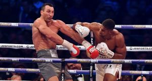 Anthony Joshua throws a punch at Ukraine's Wladimir Klitschko in Wembley Stadium on Saturday night. Photograph: Getty Images