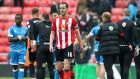 John O'Shea has said he wants to stay at Sunderland despite relegation to the Championship. Photograph: Ian MacNicol/Getty