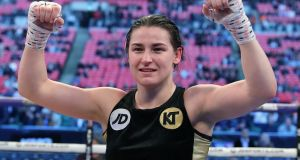 Katie Taylor celebrating winning WBA intercontinental lightweight title after beating German boxer Nina Meinke. Photograph: Lawrence Lustig/Inpho