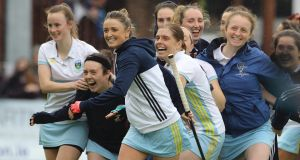 UCD players celebrate  beating Hermes-Monkstown in a penalty shootout to win EY Women's Champions Trophy Final. Photograph: Lorraine O'Sullivan/Inpho