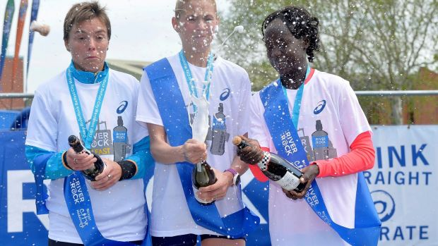 2017 Belfast City Marathon: Els Rens (second place), Laura Graham (winner) and Salome Jepkoech Kimutai (third place).