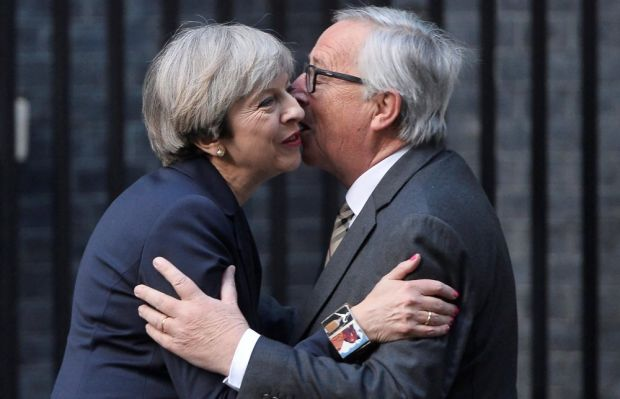 Britain's prime minister Theresa May welcomes president Juncker to Downing Street.