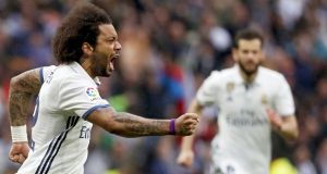 Real Madrid's Marcelo celebrates scoring the late winner in the club's  2-1 vital victory over Valencia at the  Bernabeu in  Madrid. Photograph:Javier Lizon/EPA
