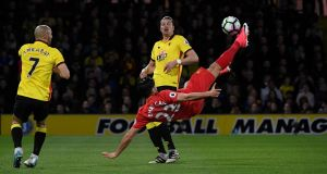 Liverpool's Emre Can scores an acrobatic goal in the Premier League match against Watford at Vicarage Road. Photograph: Toby Melville/Reuters/Livepic