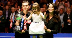 Mark Selby celebrates winning the Betfred  World Championship with wife Vikki and daughter Sofia Maria  at the Crucible Theatre in Sheffield. Photograph: Steven Paston/PA Wire