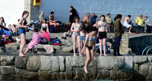 People taking the  plunge in Sandycove in Dublin on Monday. Temperatures are forecast to hit highs of 20 degrees this week. Photograph: Cyril Byrne/The Irish Times.