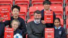 Republic of Ireland assistant manager, Roy Keane pictured with Chantelle Doyle (11), Huiming Wang (12), Andrem Tran (10) and Laya Susan-Sabu (11) all of St Mary's Primary School, Dorset St. at the  Show Racism the Red Card awards   at Tallaght Stadium. Photograph: Colin Keegan, Collins Dublin.