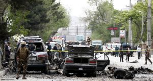 Afghan security officials inspect the site of a suicide bomb blast that targeted a Nato convoy  in Kabul on Wednesday. Photograph: Jawed Kargar/EPA