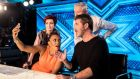 'X Factor' judges Sharon Osbourne (left) Louis Walsh and Simon Cowell (right) with Spice Girls singer Mel B (second left).