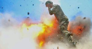 US army  photographer Hilda Clayton took this photograph on July 2nd, 2013.  It  shows an Afghan soldier engulfed in flame as a mortar tube explodes during a live-fire training exercise  in Laghman Province, Afghanistan. The accident killed Clayton and four Afghan  soldiers. Photograph: Hilda Clayton/US army via AP