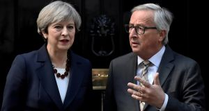Britain's Prime Minister Theresa May  and European Commission president Jean-Claude Juncker. If the talks collapse, it will be hard hat time. Photograph: Hannah McKay/Reuters