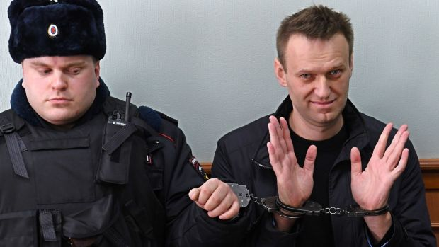 A shot from on March 30th last shows Kremlin critic Alexei Navalny, who was arrested during a March 26th anti-corruption rally, gesturing during an appeal hearing at a court in Moscow. Photograph: Kirill Kudryavtsev/AFP/Getty Images