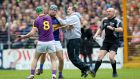 Wexford manager Davy Fitzgerald and Aidan Nolan clash with Tipperary's Jason Forde  at Nowlan Park. Photograph: Ryan Byrne/Inpho