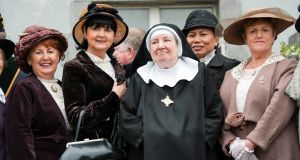 Mother Mattias of the Tyburn Order of Saint Benedict with members of the Cobh Animation Team during a plaque unveiling at at the former British Admiralty House in Cobh, which is now a convent. Photograph: Daragh Mc Sweeney/Provision