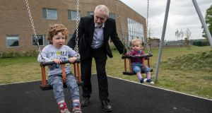 Labour Party leader Jeremy Corbyn pushes Isabella (right) and Freddie during a visit to Oxford on Thursday. Photograph: Carl Court/Getty Images)