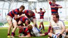 Clontarf celebrate as  Matt D'Arcy goes over for a try against Cork Con during last year's final. Photograph: Colm O'Neill/Inpho