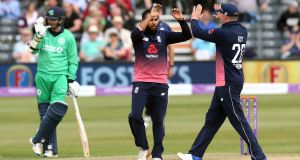 England's Adil Rashid celebrates a wicket during their one day international win over Ireland in Bristol. Photo: Andrew Fosker/Inpho