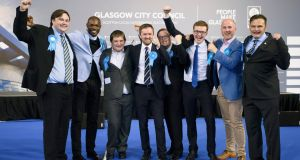 Scottish Tories:  Conservative party members Kyle Thornton, Ade Aibinu, Robert Connely, David Meikle, Thomas Kerr, Euan Blockley, Tony Curtis and Phillip Charles celebrate victory after ballot papers were counted in the local elections, at the Emirates Stadium in Glasgow. Photograph: John Linton/PA