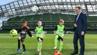 Republic of Ireland manager Martin O'Neill with, from left, Brayden Adeboye (8) Emma Sherrard 8)  and Charlie Dunwoody (9) as he launched the  FAI's Summer Schools Programme.  Photograph:  Ramsey Cardy/Sportsfile