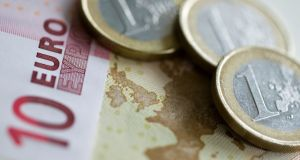 Euro notes and coins. Photograph: Chris Ratcliffe/Bloomberg
