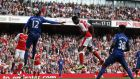 Danny Welbeck rises to score Arsenal's second in their 2-0 win over Manchester United. Photograph: Ian Kington/Afp