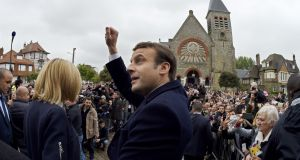 French president-elect Emmanuel Macron  waves to supporters after voting in Le Touquet, northern France, on Sunday. Photograph: Eric Feferberg/AFP/Getty Images