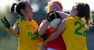 Cork's Niamh Cotter is tackled by Nicole McLaughlin and Eilish Ward of Donegal. Photograph: Tom Beary/Inpho