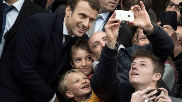 On the campaign trail: three gaffes alienated struggling French people from Macron. Photograph: Philippe Huguen/AFP/Getty Images