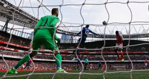 Arsenal's Danny Welbeck scores his side's second goal against Manchester United at the Emirates Stadium yesterday. Photograph: Stefan Wermuth/Livepic