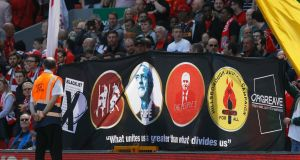Liverpool fans hold up a banner with Labour Party leader Jeremy Corbyn before the game against Southampton. Photograph:  Phil Noble/Reuters