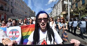 More than 700 gay rights activists marched through central Kiev on June 12th, 2016 amid a massive police presence. Photograph: Sergei Supinsky/AFP