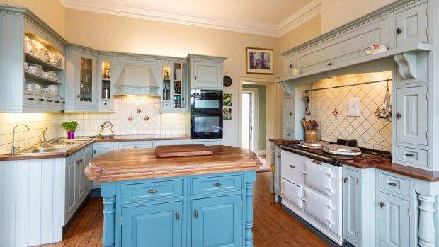 Off the dining room is a cosy duck egg blue country kitchen