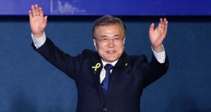 South Korean president-elect Moon Jae-in, of the Democratic Party of Korea, celebrates with supporters  in Seoul on Tuesday. Photograph: Chung Sung-Jun/Getty Images