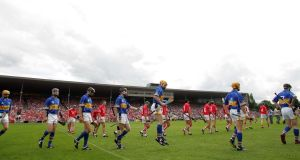 The  Cork and Tipperary teams parade before the 2006 Munster final which attracted a crowd of 53,076 to Semple Stadium in Thurles. Photograph: Morgan Treacy/Inpho